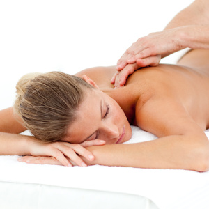 Attractive woman being massaged in a hotel